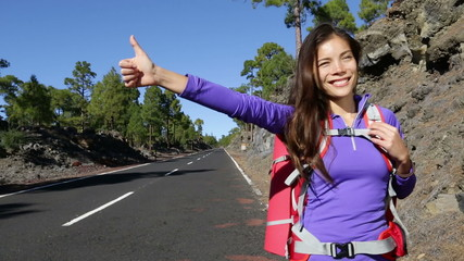 Hitchhiker woman backpacker hitchhiking