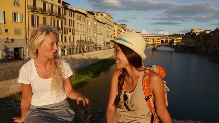 Happy women girl friends on travel in Florence