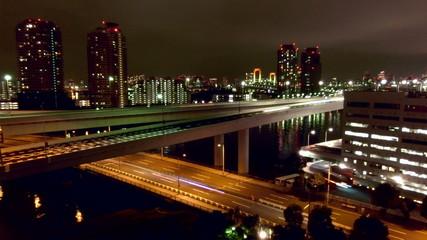 Traffic timelapse over Tokyo Rainbow Bridge.