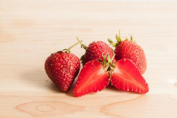 Fresh strawberry on wood.