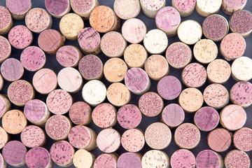 Old wine corks arranged in a background pattern