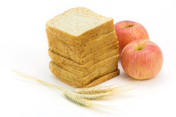 bread and apple isolated on white background,focus on bread