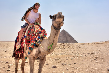 Tourist on the camel in Cairo, Egypt