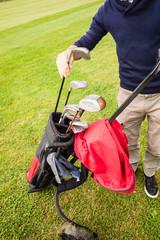 Player picking a golf club