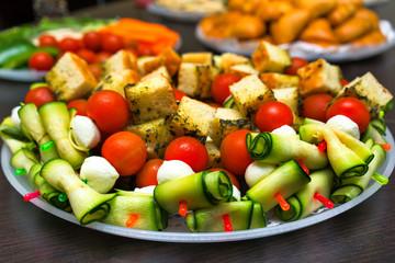Canapes sandwiches of mozzarella cheese, tomato, cucumbers