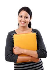 Female student holding books