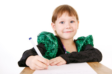 little girl in beautiful green dress with pen in hand
