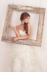 beautiful girl the bride on a background of bright stucco