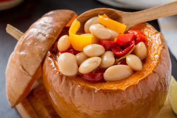 White bean and red pepper stew in pumpkin bowls .