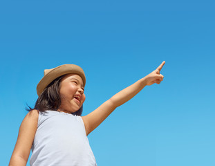 Girl pointing to the sky
