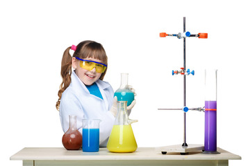 Little girl as chemist doing experiment with chemical fluid in