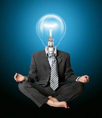 businessman in lotus pose and lamp-head