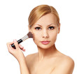 Beautiful woman with makeup brush isolated. Blonde