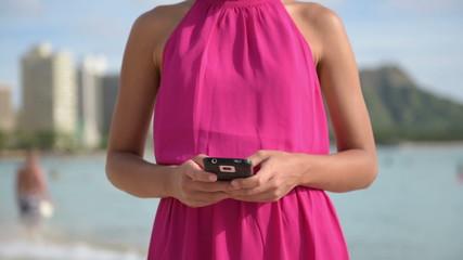 Smart phone woman using smartphone app on beach