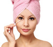 Woman with cotton swab , isolated. Skincare