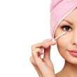Woman with cotton swab , isolated. Skincare. Beautiful