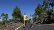 Young Fit Couple Running and Jogging on Road