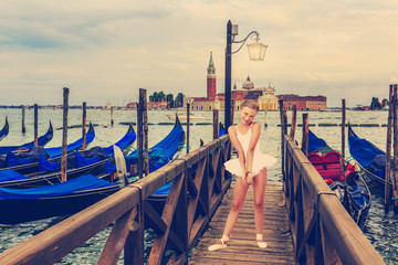 Ballet, ballerina - young and beautiful ballet dancer in Venice,