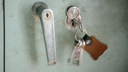 Hand-Held Luggage Locker With Key Hanging