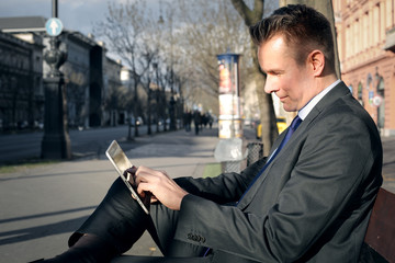 Businessman relaxing on a bench