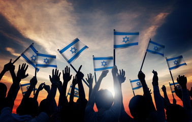 Silhouettes of People Holding Flag of Israel Concept
