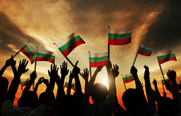 Silhouettes of People Holding Flag of Bulgaria Concept