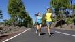 Fitness Enthusiasts Jogging Running on Road