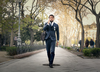 Handsome businessman walking