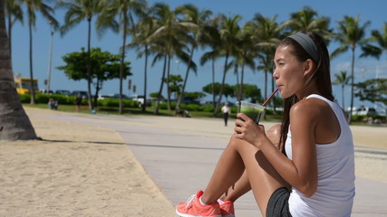 Fit Woman Resting Drinking Green Juice in Workout