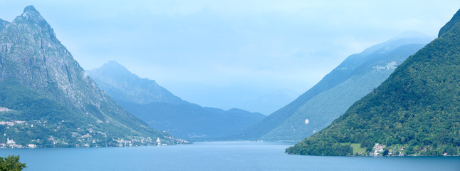 Lake Lugano summer misty view (between Switzerland and Italy).