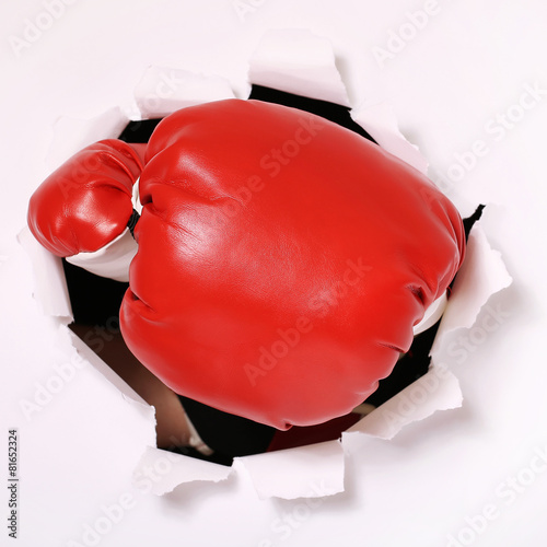 Foto op Canvas Vechtsport Hand in boxing glove through paper hole