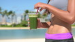 Fit Woman with Flat Abs and Healthy Green Smoothie