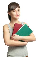 Портрет улыбающейся девушки с книгами на белом фоне