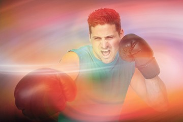 Composite image of determined male boxer focused on his training