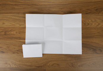 White sheet of paper folded in nine top shooting.