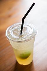Iced lemonade soda in plastic cup