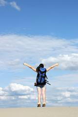 happy girl hiker with thumbs up in desert