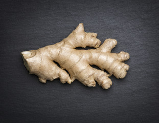 Ginger isolated on dark flagstone.