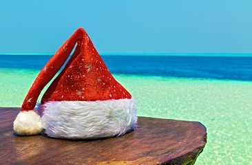 Santa hat is on a beach