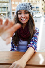 First person portrait woman smiling brightly engagingly at you