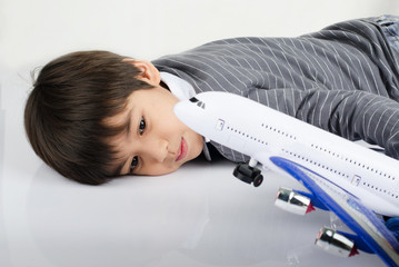 Little boy playing with airplane toy