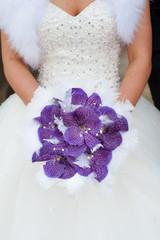 wedding bouquet of purple orchids