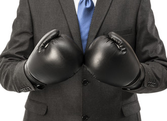 Businessman with black boxing gloves isolated on white