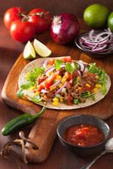 mexican taco with beef tomato salasa onion corn
