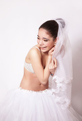 Portrait of a fun bride in veil