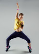 Happy girl working out zumba dance standing with hand up