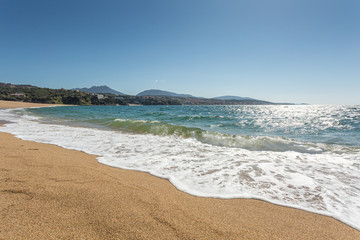 Waves lapping the beach at Propriano in Corsica