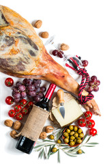 Serrano ham, wine and spanish tapas, top view