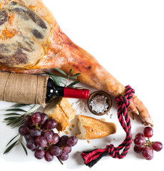 Jamon Cured Spanish, wine and grapes, top view