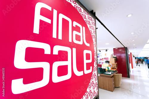sale poster board at fashion clothes shopfront - 81661335